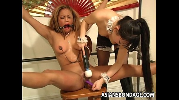 Enchanting Japanese cutie moans while being tormented
