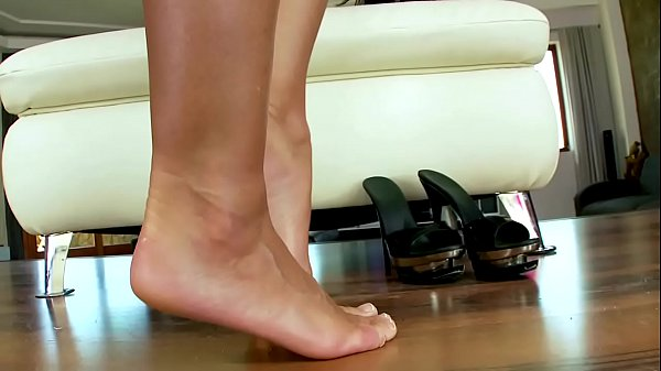 Foot fetish masturbating big titted babe on love seat