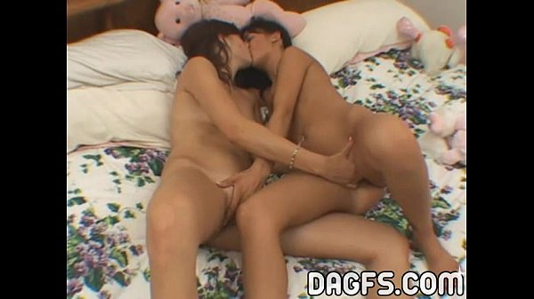 Horny lesbians eating each others clits in a bed