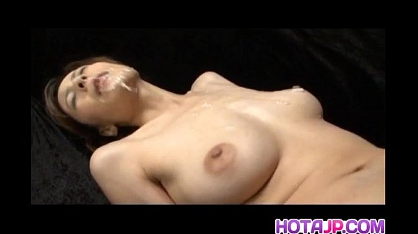 Natsumi Mitsu Japanese milf in red dress spreads hairy pussy for masturbation with a small vibrator