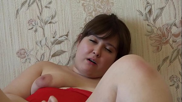 Thick girl in red masturbates her hairy pussy